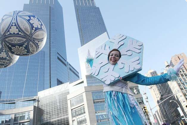 Dressed as a snowflake, Kae Burke, poses for a photograph as she makes her way through New York's Columbus Circle during the 86th Annual Macy's Thanksgiving Day Parade. Photo: Tina Fineberg, Associated Press
