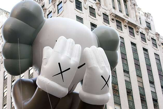 "The KAWS ""Companion"" balloon is seen during the 86th Annual Macy's Thanksgiving Day Parade. Photo: Mike Lawrie, Getty Images"