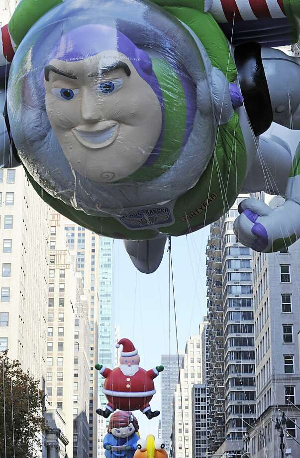 The Buzz Lightyear balloon makes his way down Sixth avenue in  the 86th annual Macy's Thanksgiving Day Parade. Photo: Louis Lanzano, Associated Press