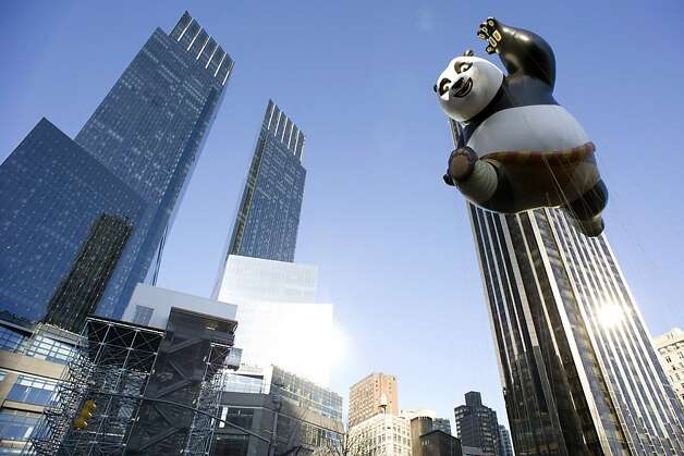 The Kung Fu Panda balloon floats in the Macy's Thanksgiving Day Parade in New York in New York, Thursday, Nov. 22, 2012.  The annual Macy's Thanksgiving Day Parade kicked off in New York on Thursday, putting a festive mood in the air in a city still coping with the aftermath of Superstorm Sandy. Photo: Charles Sykes, Associated Press