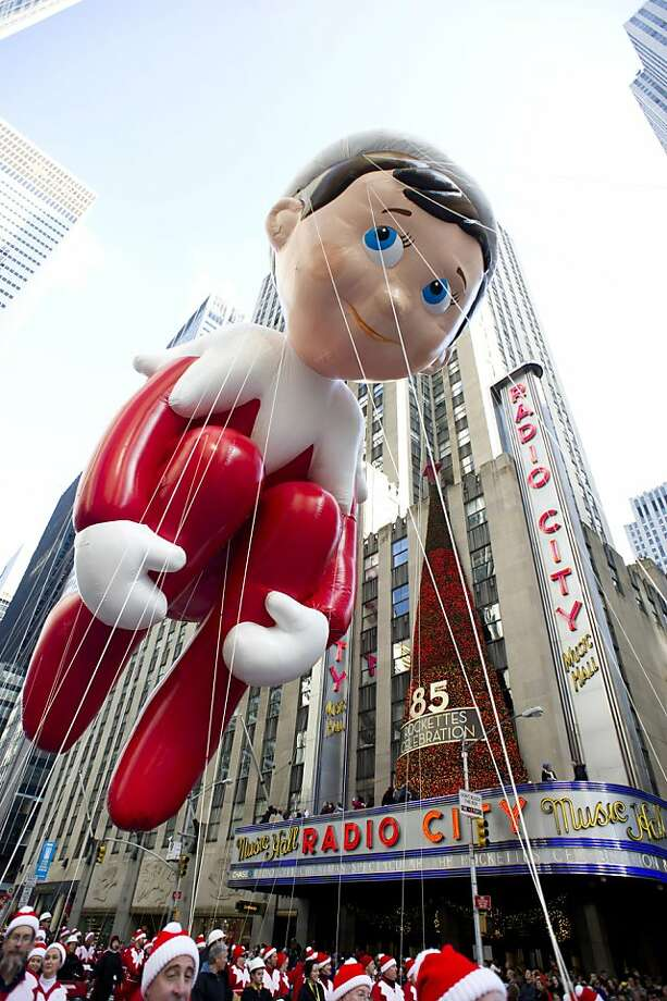 The Elf on the Shelf balloon floats in the Macy's Thanksgiving Day Parade in New York, Thursday, Nov. 22, 2012. Photo: Charles Sykes, Associated Press