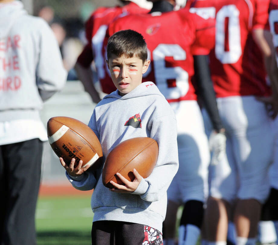 A ball boy during the FCIAC championship football game between Staples High School and Greenwich High School at Greenwich, Thursday afternoon, Nov. 22, 2012. Staples defeated Greenwich 48-30 to win the championship. Photo: Bob Luckey / Greenwich Time