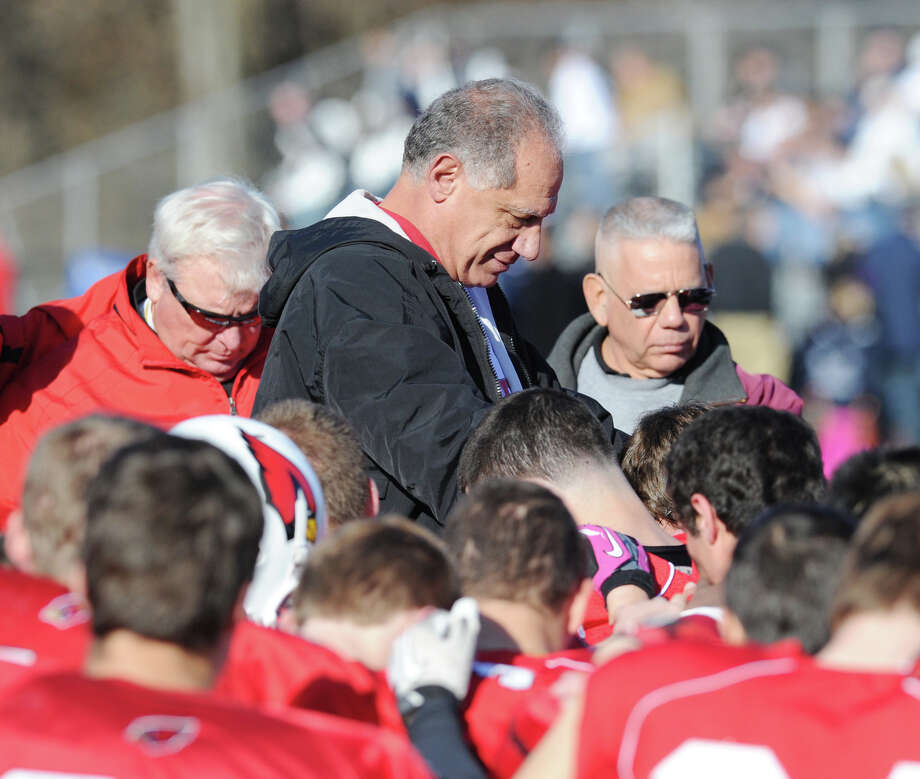Greenwich High School football coach Rich Albonizio, center, speaks with his team during the FCIAC championship football game between Staples High School and Greenwich High School at Greenwich, Thursday morning, Nov. 22, 2012. Staples defeated Greenwich 48-30 to win the championship. Photo: Bob Luckey / Greenwich Time