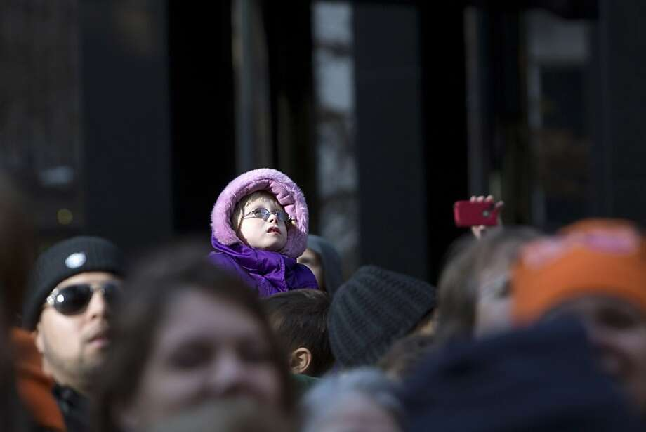 People watch as balloons make their way through the streets of Manhattan during the 86th Annual Macy's Thanksgiving Day Parade on November 22, 2012 in New York City. Photo: Andrew Kelly, Getty Images