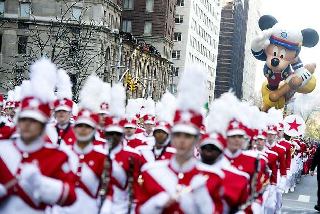 The Sailor Mickey balloon floats in the Macy's Thanksgiving Day Parade in New York, Thursday, Nov. 22, 2012. Photo: Charles Sykes, Associated Press