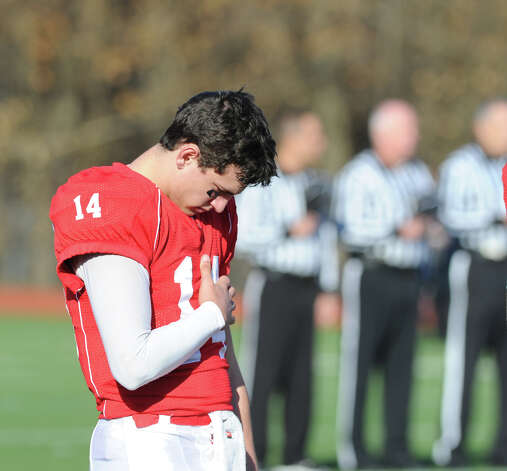 Greenwich quarterback Liam O'Neil # 14 during the National Anthem prior to the start of the FCIAC championship football game between Staples High School and Greenwich High School at Greenwich, Thursday morning, Nov. 22, 2012. Staples defeated Greenwich 48-30 to win the championship. Photo: Bob Luckey / Greenwich Time