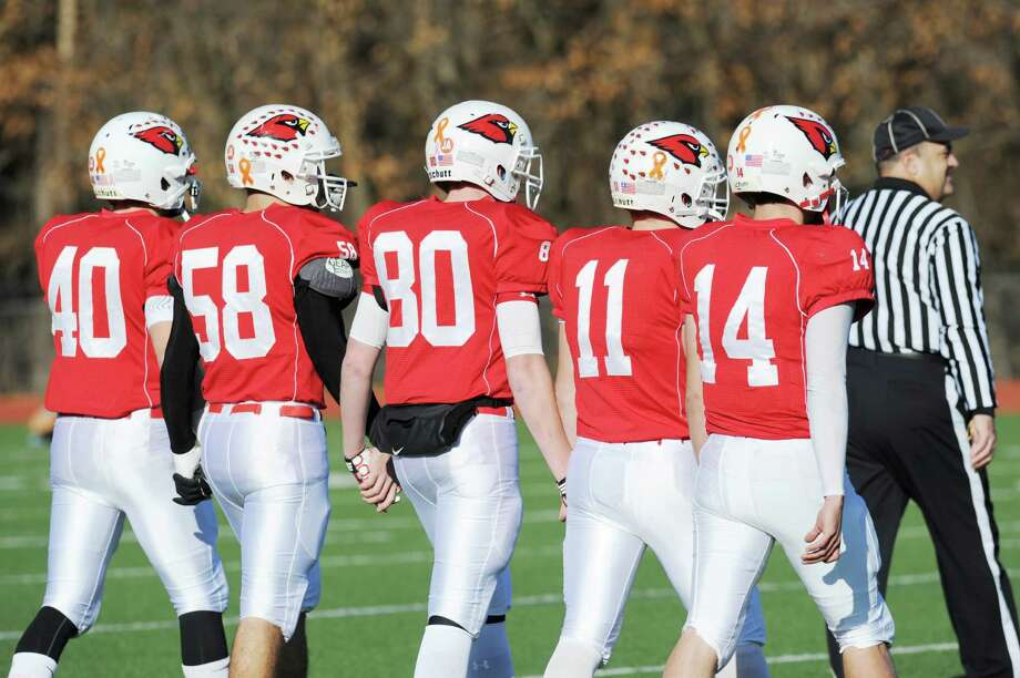 Greenwich High School football captains from left, Taylor Olmstead # 40, Alex McGee # 58, Joe Kelly # 80, Alex McMurray # 11 and Liam O'Neil # 14 during the FCIAC championship football game between Staples High School and Greenwich High School at Greenwich, Thursday afternoon, Nov. 22, 2012. Staples defeated Greenwich 48-30 to win the championship. Photo: Bob Luckey / Greenwich Time
