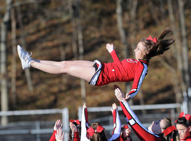 Greenwich cheerleader Jana Bartomioli, 17, during the FCIAC championship football game between Staples High School and Greenwich High School at Greenwich, Thursday afternoon, Nov. 22, 2012. Staples defeated Greenwich 48-30 to win the championship. Photo: Bob Luckey / Greenwich Time