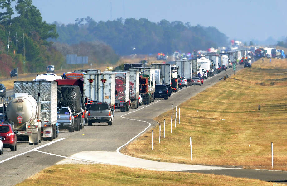 Traffic backs up on the east bound lane of Interstate 10 on Thanksgiving day Nov. 22, 2012 after a multi-vehicle accident in Southeast,Texas.  The Texas Department of Public Safety says at least 35 people have been injured in a more than 50-vehicle pileup that forced the closure of Interstate 10. (AP Photo/The Beaumont Enterprise, Guiseppe Barranco)  MANDATORY CREDIT Guiseppe Barranco/The Enterprise Photo: Guiseppe Barranco, Associated Press / The Beaumont Enterprise