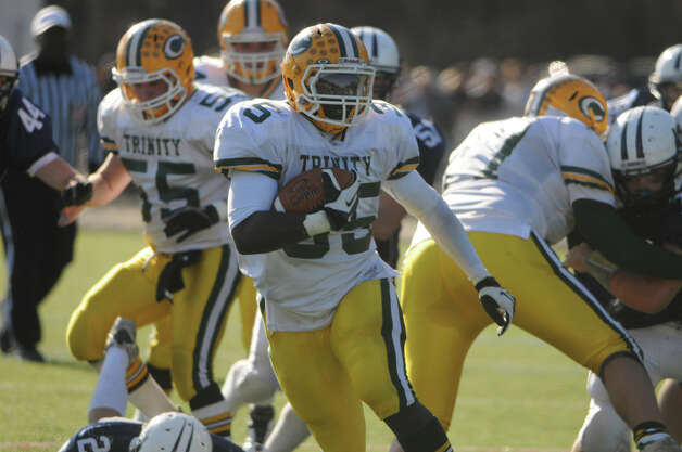 Trinity's Sean Brown carries as Wilton High School hosts Trinity Catholic in a football game in Wilton, Conn., Nov. 22, 2012. Photo: Keelin Daly / Stamford Advocate Riverbend Stamford, CT