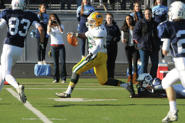 Trinity's Sean Brown heads into the endzone as Wilton High School hosts Trinity Catholic in a football game in Wilton, Conn., Nov. 22, 2012. Photo: Keelin Daly / Stamford Advocate Riverbend Stamford, CT
