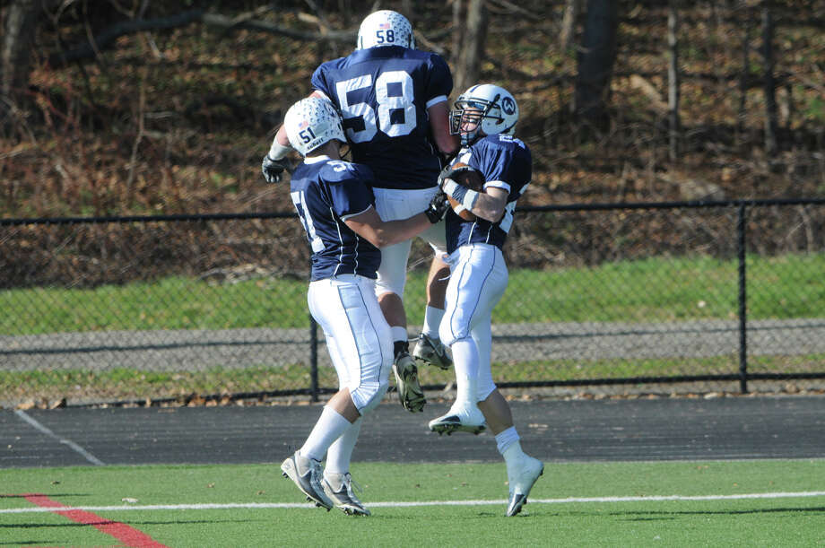 The Warriors score as Wilton High School hosts Trinity Catholic in a football game in Wilton, Conn., Nov. 22, 2012. Photo: Keelin Daly / Stamford Advocate Riverbend Stamford, CT