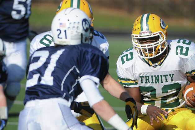 Trinity's Shaquan Howsie looks to break through Wilton's defensive line as Wilton High School hosts Trinity Catholic in a football game in Wilton, Conn., Nov. 22, 2012. Photo: Keelin Daly / Stamford Advocate Riverbend Stamford, CT