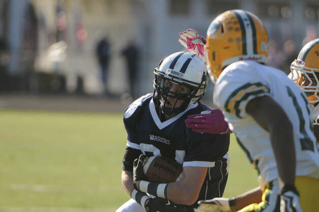 Wilton's Mike Burns carries as Wilton High School hosts Trinity Catholic in a football game in Wilton, Conn., Nov. 22, 2012. Photo: Keelin Daly / Stamford Advocate Riverbend Stamford, CT
