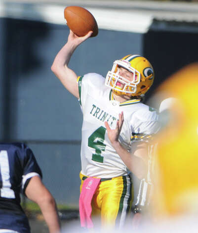 Trinity's Danny O'Leary throws as Wilton High School hosts Trinity Catholic in a football game in Wilton, Conn., Nov. 22, 2012. Photo: Keelin Daly / Stamford Advocate Riverbend Stamford, CT