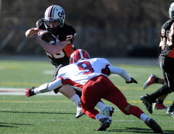 Shelton's Matthew Feigenblat tries to avoid a tackle from Derby's Brian Eliasson during the Thanksgiving Day football game Thursday, Nov. 22, 2012 at Shelton High School. Photo: Autumn Driscoll / Connecticut Post