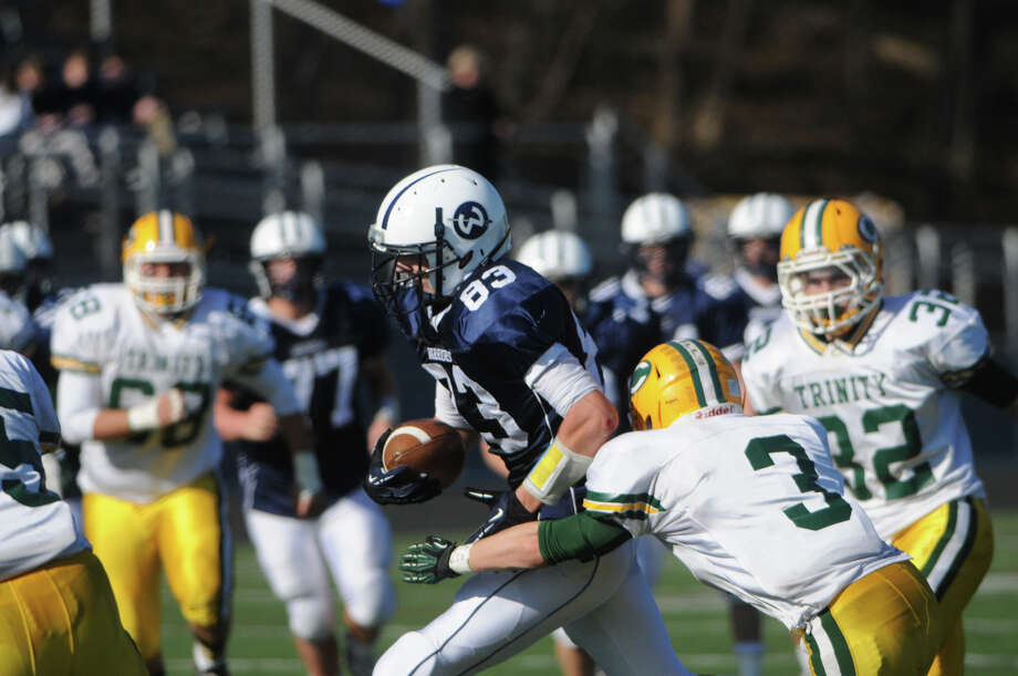 Wilton's Weston Wilbur carries as Wilton High School hosts Trinity Catholic in a football game in Wilton, Conn., Nov. 22, 2012. Photo: Keelin Daly / Stamford Advocate Riverbend Stamford, CT