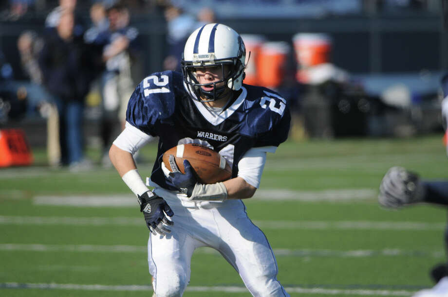 Wilton's Patrick Ryan in action as Wilton High School hosts Trinity Catholic in a football game in Wilton, Conn., Nov. 22, 2012. Photo: Keelin Daly / Stamford Advocate Riverbend Stamford, CT
