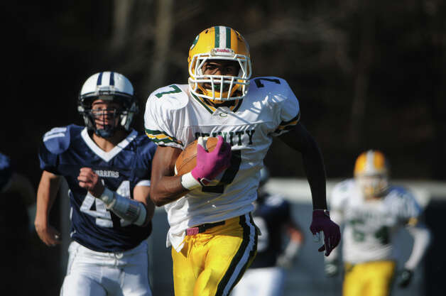 Trinity's Neno Merritt carries as Wilton High School hosts Trinity Catholic in a football game in Wilton, Conn., Nov. 22, 2012. Photo: Keelin Daly / Stamford Advocate Riverbend Stamford, CT