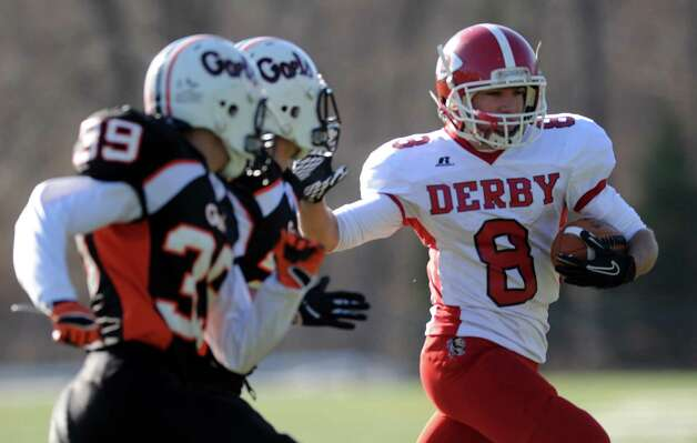 Derby quarterback Michael Kreiger carries the ball during the Thanksgiving Day football game against Shelton Thursday, Nov. 22, 2012 at Shelton High School. Photo: Autumn Driscoll / Connecticut Post
