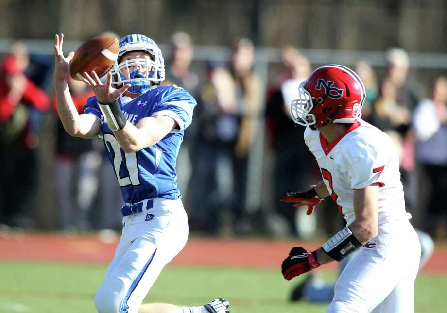 Darien RB Nick Lombardo hauls in a Henry Baldwin touchdown pass for a score as New Canaan defender Grady Lynch defends. The Blue Wave won the Turkey Day game for the first time in 11 years, clobbering New Canaan, 36-23. Photo: J. Gregory Raymond / Stamford Advocate Freelance;  © J. Gregory Raymond