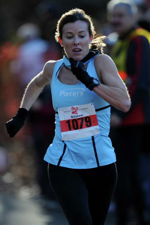 Kristen Henehan, of Kensington, MD, finishes the 35th annual Pequot Runners Thanksgiving Day Five-Mile Race Thursday, Nov. 22, 2012 in Fairfield, Conn.  Henehan was the first female finisher with a time of 29:50. Photo: Autumn Driscoll / Connecticut Post