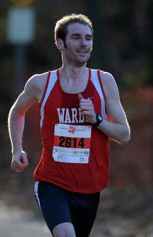 Matthew Kane, of Fairfield, finishes the 35th annual Pequot Runners Thanksgiving Day Five-Mile Race in first place Thursday, Nov. 22, 2012 in Fairfield, Conn. Photo: Autumn Driscoll / Connecticut Post