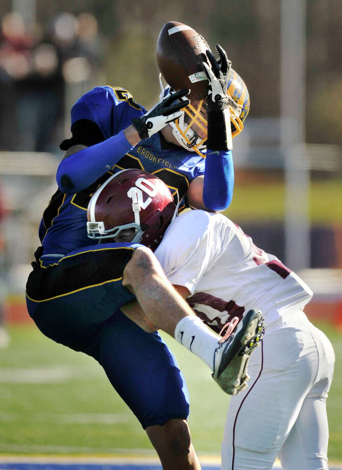 Bethel's James Giannone tackles Brookfield's Liam Clancy forcing Clancy to drop the ball during their game at Brookfield High School on Thursday, Nov. 22, 2012. Photo: Jason Rearick / The News-Times
