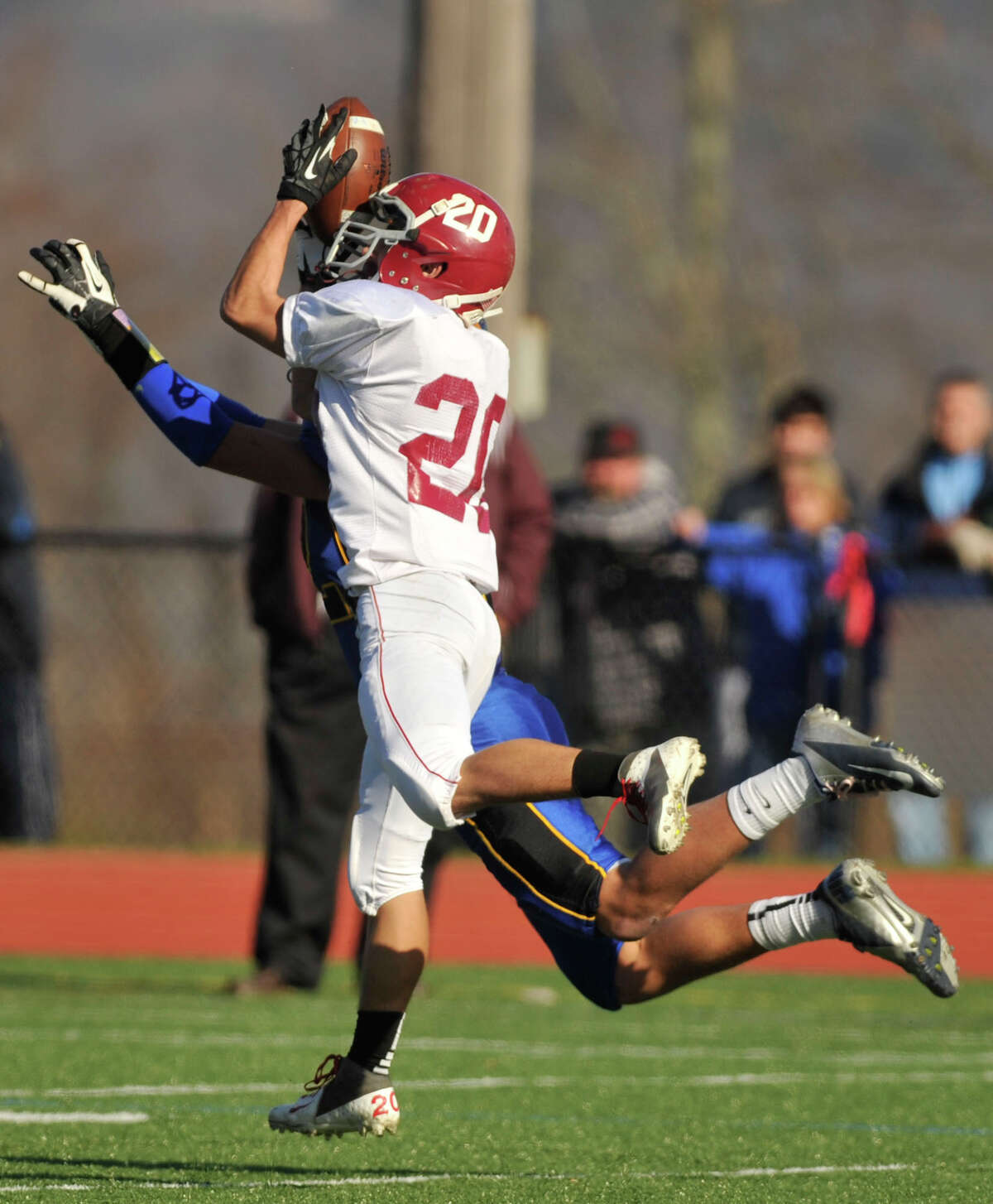 Bethel's James Giannone intercepts the ball from Brookfield's Liam Clancy during their game at Brookfield High School on Thursday, Nov. 22, 2012.