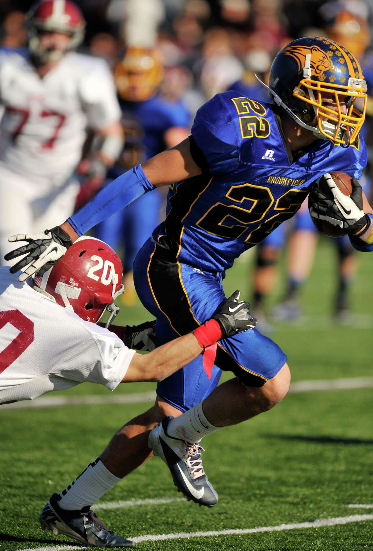 Brookfield's Liam Clancy evades the tackle of Bethel's James Giannone during their game at Brookfield High School on Thursday, Nov. 22, 2012.