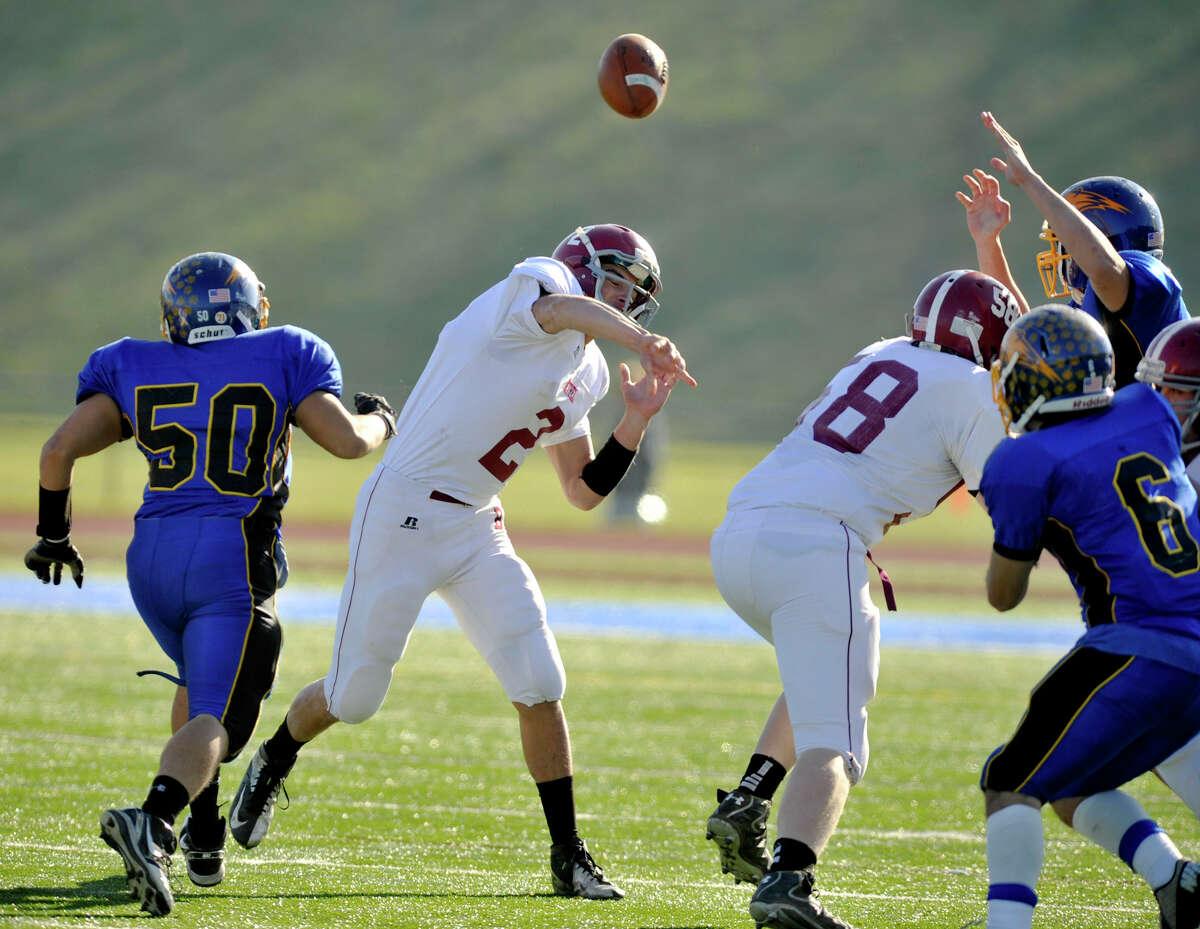 Bethel quarterback Joseph Piatnik throws the ball during their game against Brookfield at Brookfield High School on Thursday, Nov. 22, 2012.