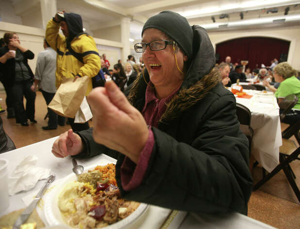 Charlene Payne of Bridgeport enjoys the annual Thanksgiving feast at the United Congregational Church in Bridgeport on Thursday, November 22, 2012. Photo: Brian A. Pounds / Connecticut Post