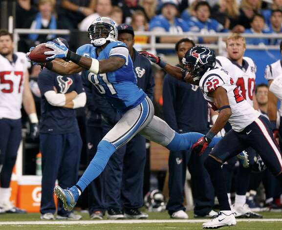 Calvin Johnson #81 of the Detroit Lions makes a second quarter catch in front of Alan Ball #22 of the Houston Texans at Ford Field on November 22, 2012 in Detroit, Michigan. Photo: Gregory Shamus, Getty Images / 2012 Getty Images