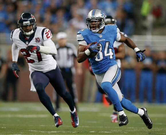Ryan Broyles #84 of the Detroit Lions runs for extra yards after a second quarter catch in front of Quintin Demps #27 of the Houston Texans at Ford Field on November 22, 2012 in Detroit, Michigan. Photo: Gregory Shamus, Getty Images / 2012 Getty Images