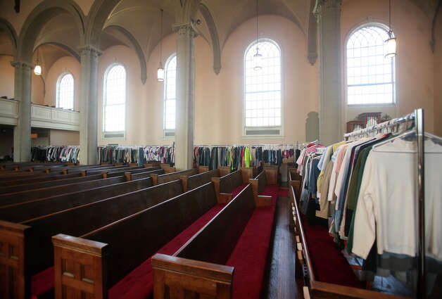 Racks of clothing for the needy line the aisles of the sanctuary at the United Congregational Church in Bridgeport on Thursday, November 22, 2012. Photo: Brian A. Pounds / Connecticut Post