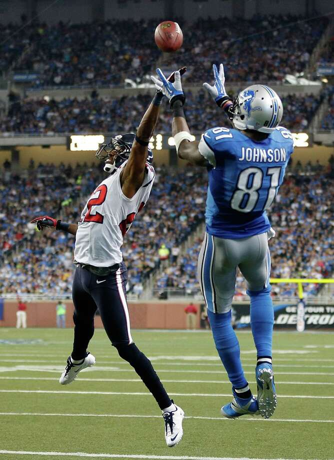Alan Ball #22 of the Houston Texans tries to defend a second quarter touchdown catch by Calvin Johnson #81 of the Detroit Lions at Ford Field on November 22, 2012 in Detroit, Michigan. Photo: Gregory Shamus, Getty Images / 2012 Getty Images