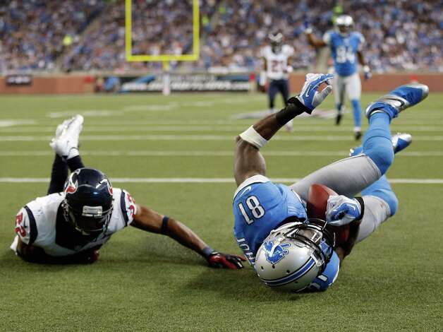 Calvin Johnson #81 of the Detroit Lions makes a second quarter touchdown catch next to Alan Ball #22 of the Houston Texans at Ford Field on November 22, 2012 in Detroit, Michigan. Photo: Gregory Shamus, Getty Images / 2012 Getty Images
