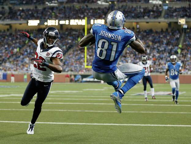 Calvin Johnson #81 of the Detroit Lions makes a second quarter touchdown catch behind the defense of Alan Ball #22 of the Houston Texans at Ford Field on November 22, 2012 in Detroit, Michigan. Photo: Gregory Shamus, Getty Images / 2012 Getty Images
