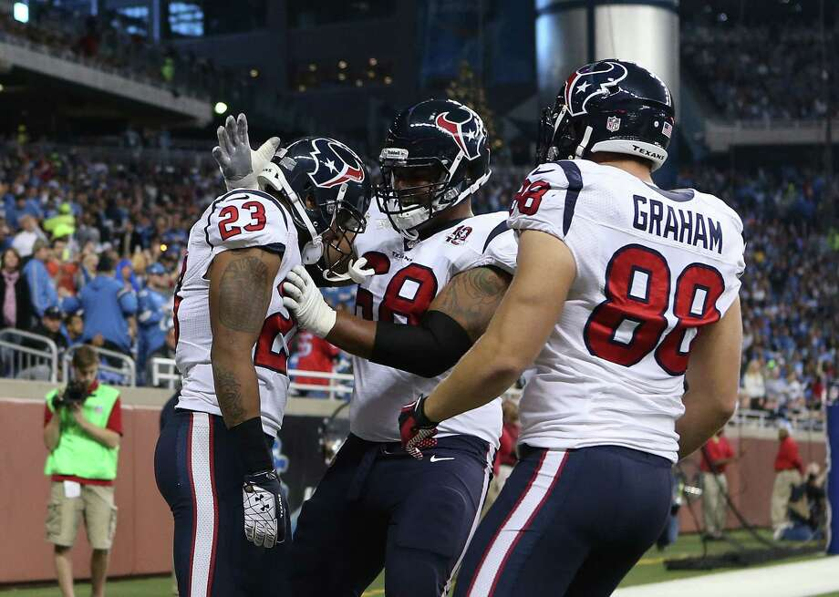 Arian Foster #23 of the Houston Texans celebrates with teammates Garrett Graham #88 and Ryan Harris #68 after scoring on a six yard touchdown during the game against the Detroit Lions at Ford Field on November 22, 2012 in Detroit, Michigan. Photo: Leon Halip, Getty Images / 2012 Getty Images
