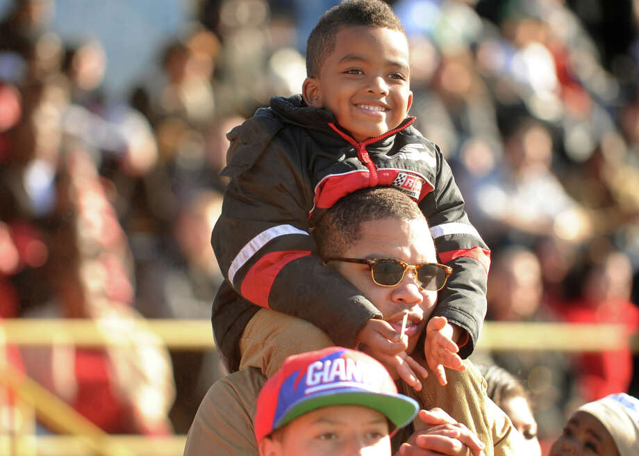 James Stephenson and his son Jeremiah, 5 of Bridgeport, enjoy the Central vs. Harding football game at Harding High School in Bridgeport on Sunday, November 22, 2012. Photo: Brian A. Pounds / Connecticut Post