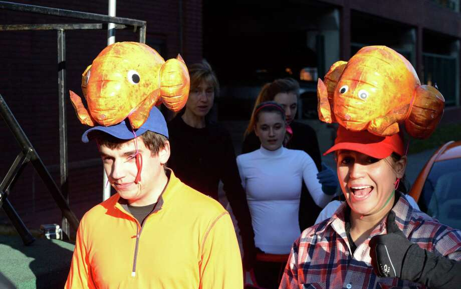 Turkey Heads James and Kristy Kolb of East Greenbush arrive for the 65th running of the Troy Turkey Trot in Troy, N.Y. Nov 22, 2012.     (Skip Dickstein/Times Union) Photo: Skip Dickstein / 00020181A
