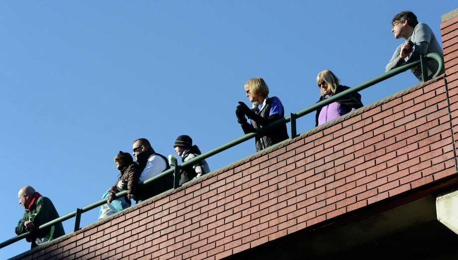Spectators line the top level of the Atrium parking garage for the start of the 65th running of the Troy Turkey Trot in Troy, N.Y. Nov 22, 2012.     (Skip Dickstein/Times Union) Photo: Skip Dickstein / 00020181A