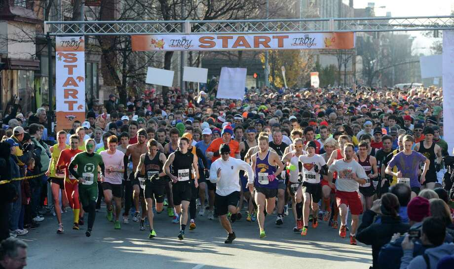 5173 runners who finished the 65th running of the Troy Turkey Trot in Troy, N.Y.  break away from the start of the 5K race Nov 22, 2012.     (Skip Dickstein/Times Union) Photo: Skip Dickstein / 00020181A