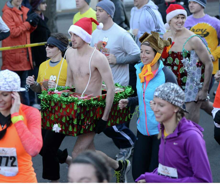 Different costumes were worn by some of the approximately 5500 runners entered in the 65th running of the Troy Turkey Trot in Troy, N.Y.  breaks away from the start of the 5K race Nov 22, 2012.     (Skip Dickstein/Times Union) Photo: Skip Dickstein / 00020181A