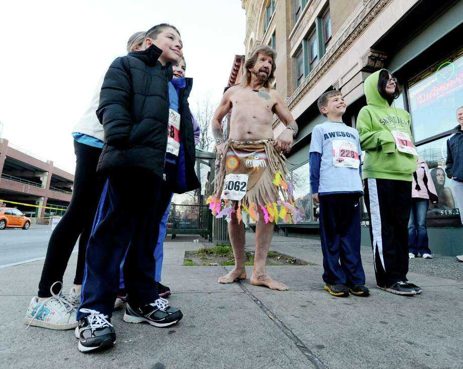 Forey Jacobson of Des Moines, Iowa, center, poses for pictures before the 5K race of the 65th running of the Troy Turkey Trot in Troy, N.Y. Nov 22, 2012.     (Skip Dickstein/Times Union) Photo: Skip Dickstein / 00020181A