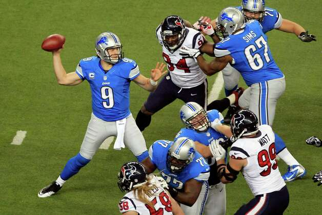 Detroit Lions quarterback Matthew Stafford (9) throws a pass during the first quarter of an NFL football game against the Houston Texans at Ford Field in Detroit, Thursday, Nov. 22, 2012. (AP Photo/Carlos Osorio) Photo: Carlos Osorio, Associated Press / AP