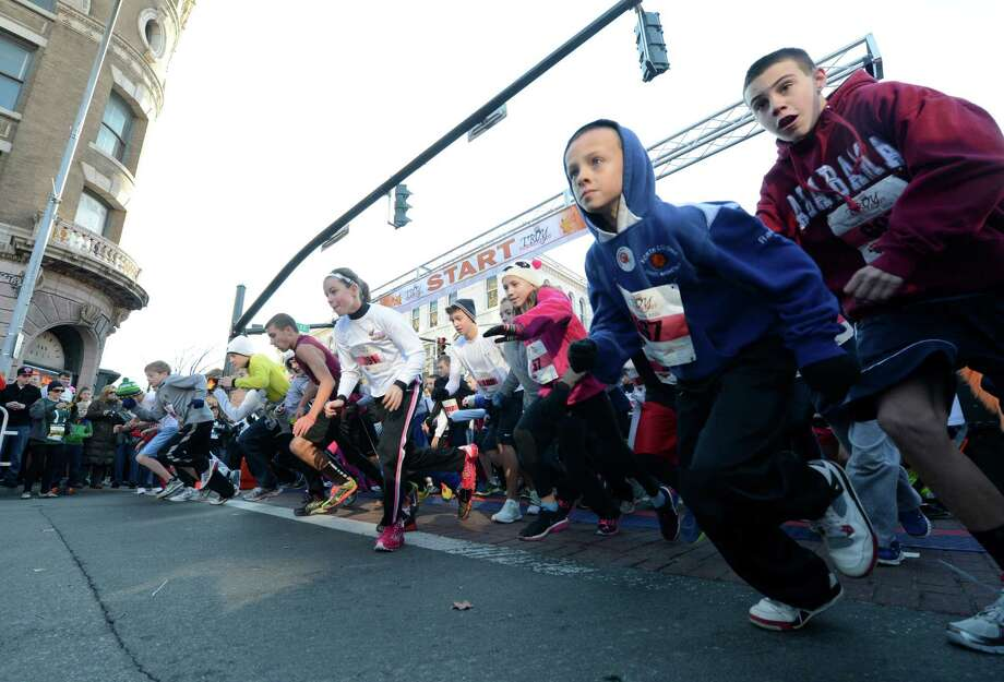Starters in the Grade School Mile/Turkey Walk leave the starting line during the 65th running of the Troy Turkey Trot in Troy, N.Y. Nov 22, 2012.     (Skip Dickstein/Times Union) Photo: Skip Dickstein / 00020181A