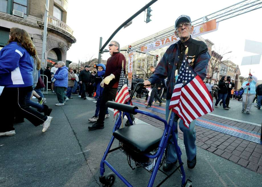 99 year old WWII veteran Ernest Blanchett of Sycaway participates in the Turkey Walk race  of the 65th running of the Troy Turkey Trot in Troy, N.Y. Nov 22, 2012.     (Skip Dickstein/Times Union) Photo: Skip Dickstein / 00020181A