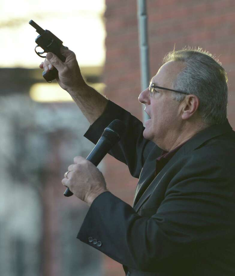 Troy Mayor Lou Rosamilia holds up the starters' pistol before the start of the 10K race of  the 65th running of the Troy Turkey Trot in Troy, N.Y. Nov 22, 2012.     (Skip Dickstein/Times Union) Photo: Skip Dickstein / 00020181A