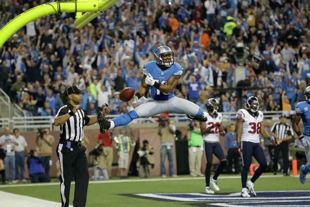 Detroit Lions receiver Mike Thomas celebrates his 5-yard touchdown reception during the second quarter of an NFL football game against the Houston Texans at Ford Field in Detroit, Thursday, Nov. 22, 2012. (AP Photo/Paul Sancya) Photo: Paul Sancya, Associated Press / AP